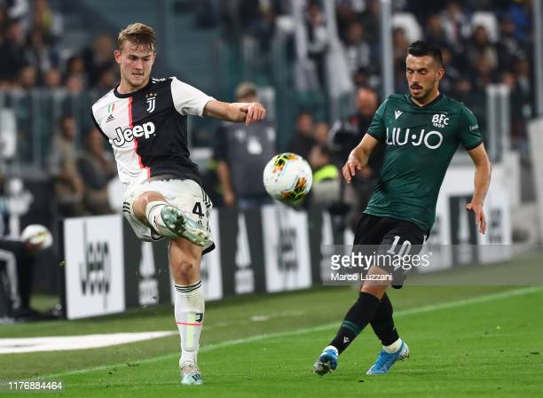 Matthijs de Ligt of Juventus FC is challenged by Nicola Sansone of Bologna FC during the Serie A match between Juventus and Bologna FC at Allianz...