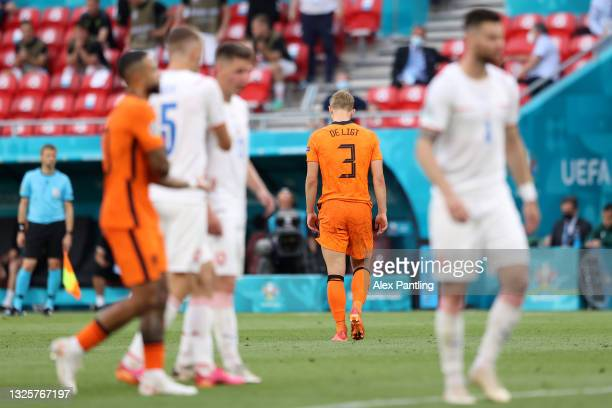 Matthijs de Ligt of Netherlands leaves the field after being shown a red card following a VAR review during the UEFA Euro 2020 Championship Round of...