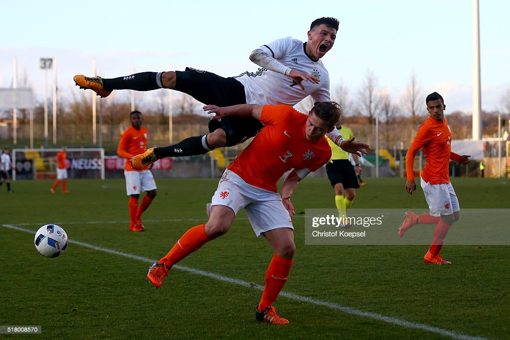 Matthijs de Ligt of the Netherlands (R) challenges Renat Dadachov of Germany (L) during the U17 Euro Qualification match between Germany and Netherlands at Paul Janes Stadium on March 29, 2016 at Esprit-Arena in Duesseldorf, Germany.