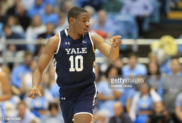 Matthue Cotton of the Yale Bulldogs reacts after a play against the North Carolina Tar Heels during their game at Dean Smith Center on December 30...