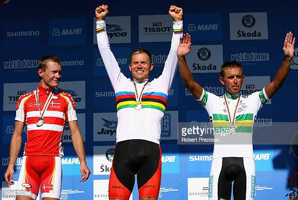 Matti Breschel of Denmark Thor Hushovd of Norway and Allan Davis of Australia celebrate after the Elite Men's Road Race on day five of the UCI Road...