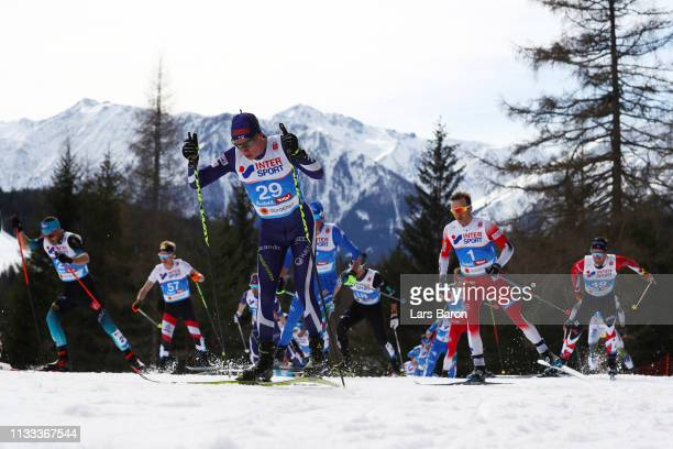 Matti Heikkinen of Finland and Sjur Roethe of Norway compete in the Men's Cross Country 50k race during the FIS Nordic World Ski Championships on...