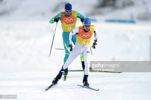 Matti Heikkinen of Finland and Vitaliy Pukhkalo of Kazakhstan compete in the third leg during CrossCountry Skiing men's 4x10km relay on day nine of...