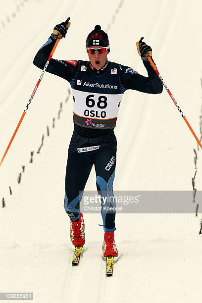 Matti Heikkinen of Finland celebrates as he crosses the finish line to win the gold medal in the Men's Cross Country 15km Classic race during the FIS...