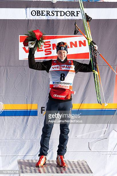 Matti Heikkinen of Finland celebrates on the podium after winning the men's pursuit for the FIS Cross Country World Cup Tour de Ski on January 3 2011...