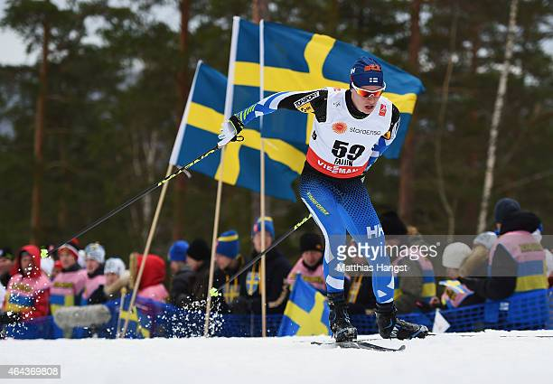 Matti Heikkinen of Finland competes during the Men's 15km CrossCountry during the FIS Nordic World Ski Championships at the Lugnet venue on February...