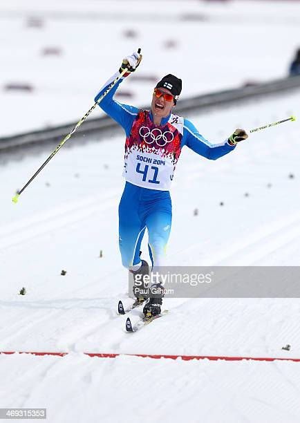 Matti Heikkinen of Finland competes in the Men's 15 km Classic during day seven of the Sochi 2014 Winter Olympics at Laura Crosscountry Ski Biathlon...
