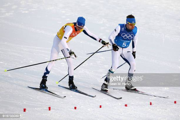 Matti Heikkinen of Finland completes the third leg as teammate Lari Lehtonen of Finland continues during CrossCountry Skiing men's 4x10km relay on...