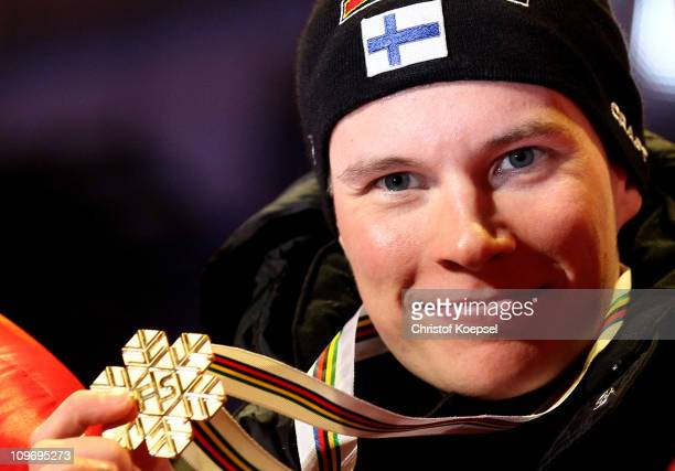 Matti Heikkinen of Finland poses with the gold medal won in the Men's Cross Country 15km Classic race during the FIS Nordic World Ski Championships...