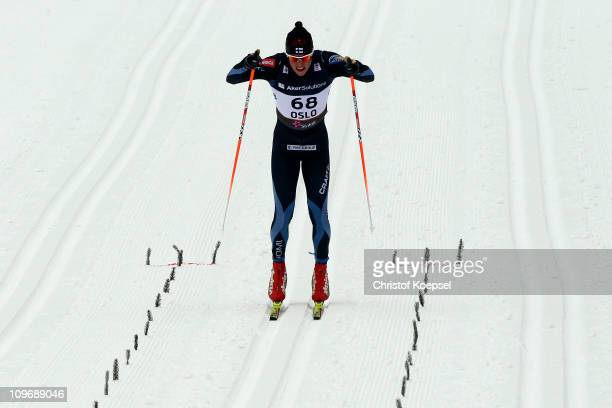 Matti Heikkinen of Finland powers towards the finish line to win the gold medal in the Men's Cross Country 15km Classic race during the FIS Nordic...