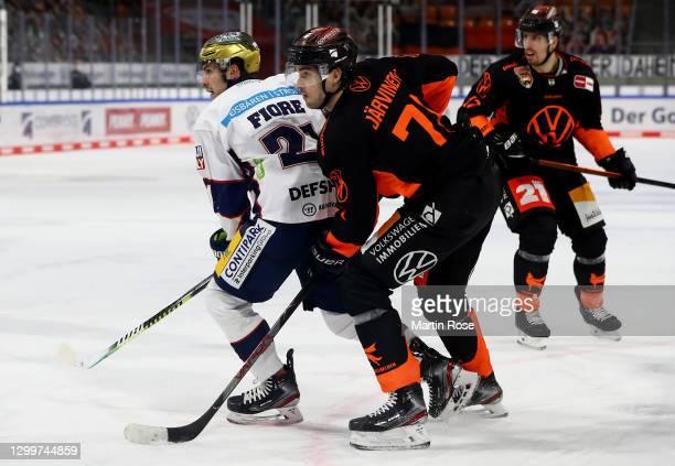 Matti Järvinen of Grizzlys Wolfsburg challenges Giovanni Fiore of Eisbären Berlin during the Deutsche Eishockey Liga DEL match between Grizzlys...