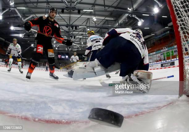 Matti Järvinen of Grizzlys Wolfsburg challenges Tobias Ancicka, goaltender of Eisbären Berlin during the Deutsche Eishockey Liga DEL match between...