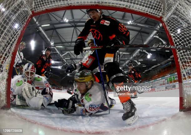 Matti Järvinen of Grizzlys Wolfsburg tries to score over Tobias Ancicka, goaltender of Eisbären Berlin during the Deutsche Eishockey Liga DEL match...