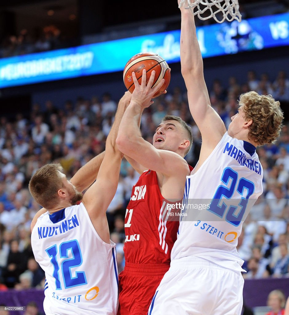 Matti Nuutinen of Finland, Tomasz Gielo of Poland, Lauri Markkanen of Finland during the FIBA Eurobasket 2017 Group A match between Finland and Poland on September 3, 2017 in Helsinki, Finland.