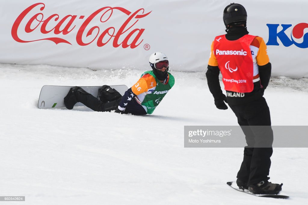 Matti Suur-Hamari (L) of Finland and Evan Strong (R) of the United States are seen after the Men's Snowboard Cross SB-LL2 semi-finalduring day three of the PyeongChang 2018 Paralympic Games on March 12, 2018 in Pyeongchang-gun, South Korea.