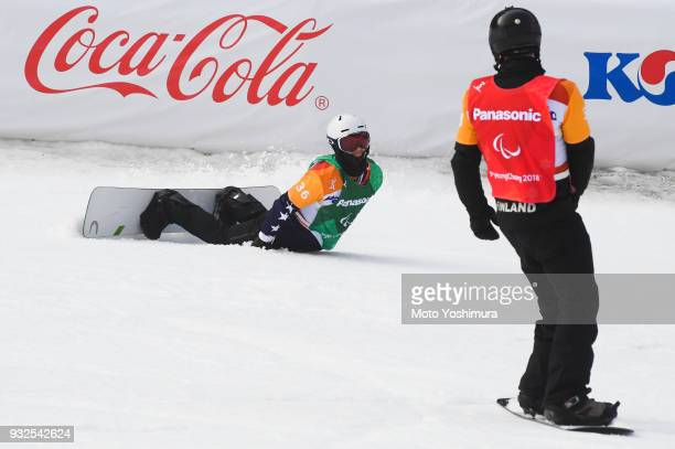 Matti SuurHamari of Finland and Evan Strong of the United States are seen after the Men's Snowboard Cross SBLL2 semifinalduring day three of the...