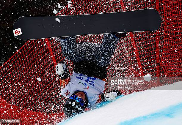 Matti SuurHamari of Finland crashes during the Men's Para Snowboard Cross Standing on day seven of the Sochi 2014 Paralympic Winter Games at Rosa...