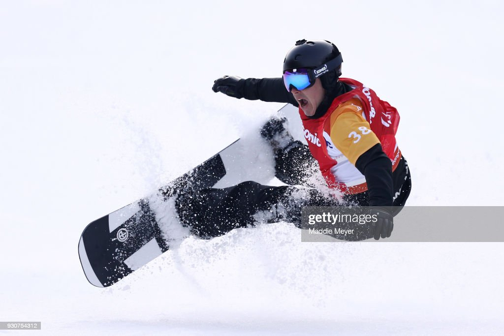 Matti Suur-Hamari of Finland stumbles after celebrating winning the Gold medal in the Men's Snowboard Cross SB-LL2 during day three of the PyeongChang 2018 Paralympic Games on March 12, 2018 in Pyeongchang-gun, South Korea.