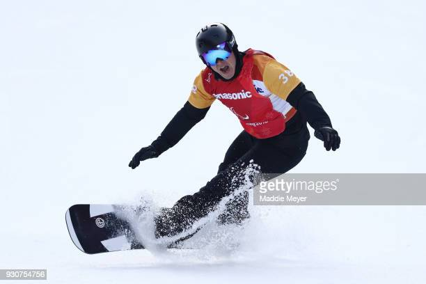 Matti SuurHamari of Finland stumbles after celebrating winning the Gold medal in the Men's Snowboard Cross SBLL2 during day three of the PyeongChang...