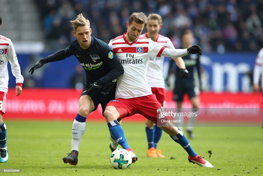 Matti Ville Steinmann (R) of Hamburg and Arne Maier (L) of Berlin compete for the ball during the Bundesliga match between Hamburger SV and Hertha BSC at Volksparkstadion on March 17, 2018 in Hamburg, Germany.
