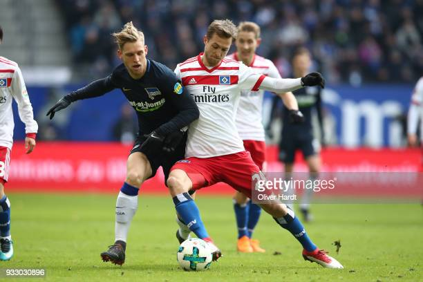 Matti Ville Steinmann of Hamburg and Arne Maier of Berlin compete for the ball during the Bundesliga match between Hamburger SV and Hertha BSC at...