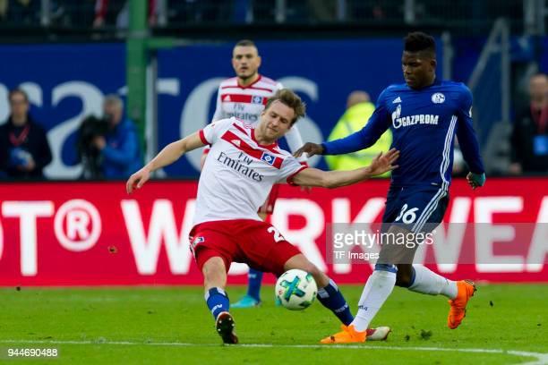 Matti Ville Steinmann of Hamburg and Breel Embolo of Schalke battle for the ball during the Bundesliga match between Hamburger SV and FC Schalke 04...