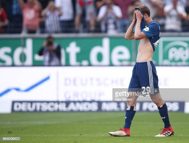 Matti Ville Steinmann of Hamburg covers his face after Alexander Meier of Frankfurt scored a goal to make it 30 during the Bundesliga match between...