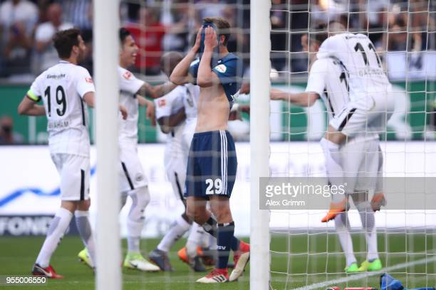 Matti Ville Steinmann of Hamburg covers his face after Alexander Meier of Frankfurt scored a goal to make it 30 during the Bundesliga match between...
