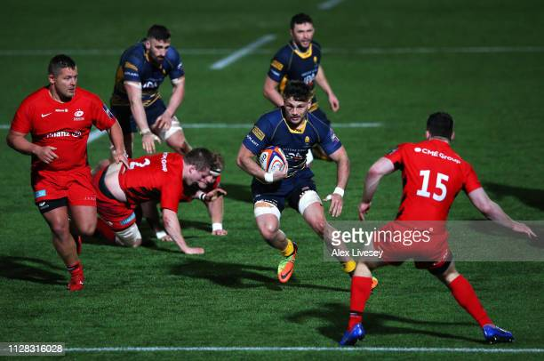 Matti Williams of Worcester Warriors is faced by Matt Gallagher of Saracens as he runs with the ball during the Premiership Rugby Cup semifinal match...