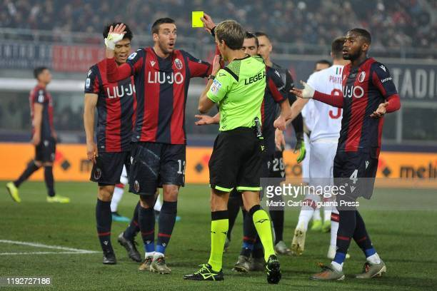 Mattia Bani of Bologna FC reacts after a yellow card for committing a foul into the penalty area during the Serie A match between Bologna FC and AC...