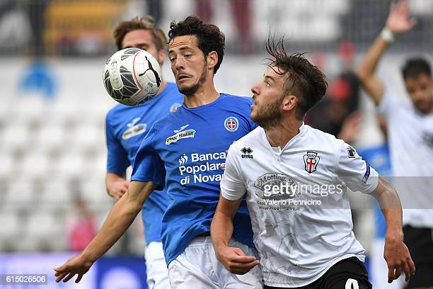 Mattia Bani of FC Pro Vercelli competes with Adorjan Kristzian of Novara Calcio during the Serie B match between FC Pro Vercelli and Novara Calcio at...
