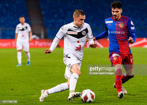 Mattia Bottani of Lugano plays against Raoul Petretta of Basel during the match between FC Basel 1893 and FC Lugano at St. Jakob-Park Stadium on May...