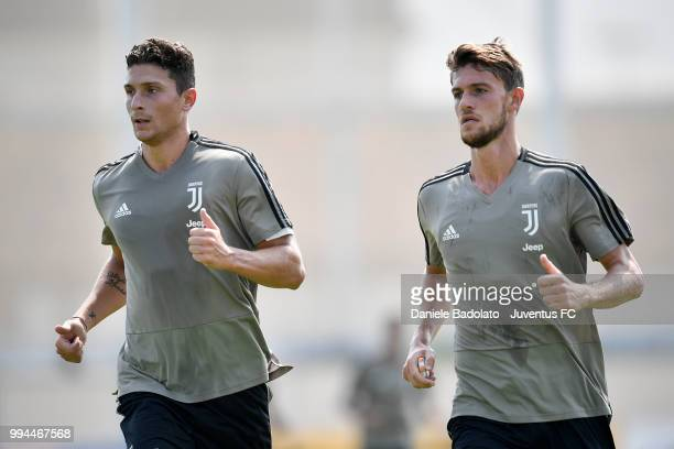 Mattia Caldara and Daniele Rugani during a Juventus training session at Juventus Training Center on July 9 2018 in Turin Italy