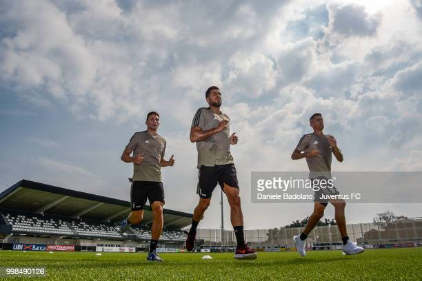 Mattia Caldara Emre Can and Joao Cancelo during a Juventus morning training session on July 14 2018 in Turin Italy