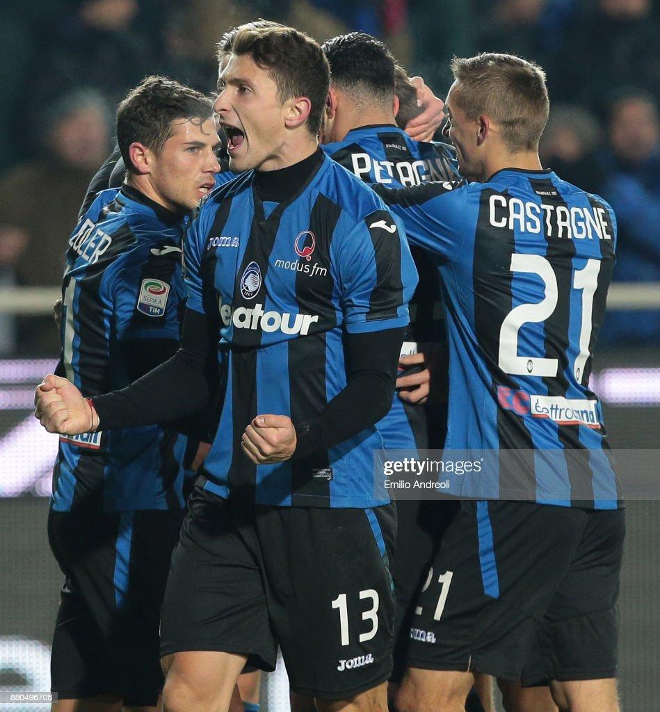 Mattia Caldara of Atalanta BC (C) celebrates after his team-mate Bryan Cristante scored during the Serie A match between Atalanta BC and Benevento Calcio at Stadio Atleti Azzurri d'Italia on November 27, 2017 in Bergamo, Italy.