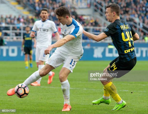Mattia Caldara of Atalanta BC competes for the ball with Ivan Perisic of FC Internazionale Milano during the Serie A match between FC Internazionale...