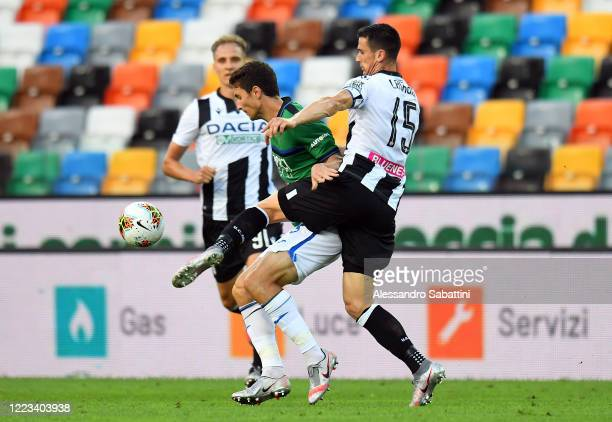 Mattia Caldara of Atalanta BC competes for the ball with Kevin Lasagna of Udinese Calcio during the Serie A match between Udinese Calcio and Atalanta...