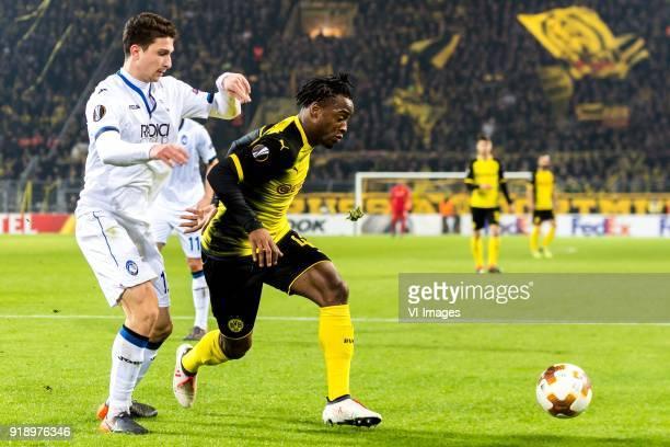 Mattia Caldara of Atalanta Bergamo Michy Batshuayi of Borussia Dortmund during the UEFA Europa League round of 32 match between Borussia Dortmund and...