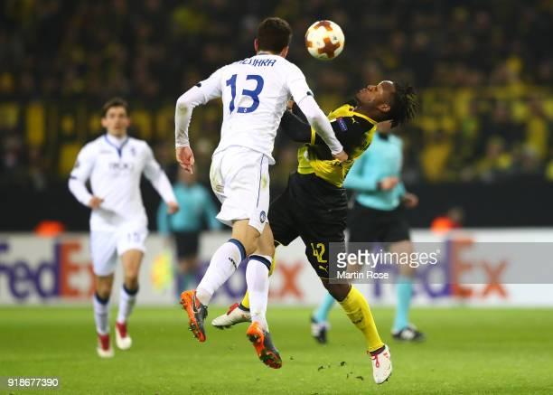 Mattia Caldara of Atalanta challenges Michy Batshuayi of Borussia Dortmund reacts during UEFA Europa League Round of 32 match between Borussia...