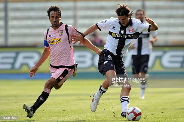 Mattia Cassani of Palermo and Davide Lanzafame of Parma battle for the ball during Serie A match played between Parma FC and US Citta di Palermo at...
