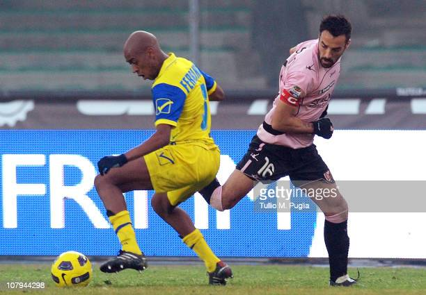 Mattia Cassani of Palermo and Gelson Fernandes of Chievo compete for the ball during the Serie A match between AC Chievo Verona and US Citta di...
