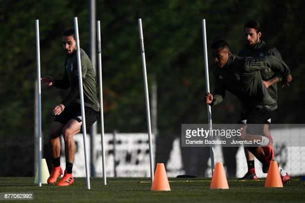 Mattia De Sciglio and Alex Sandro during the Champions League training session at Juventus Center Vinovo on November 21 2017 in Vinovo Italy