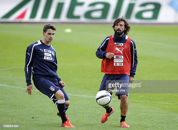 Mattia De Sciglio and Andrea Pirlo compete for the ball during an Italy training session at Renato Dall'Ara stadium on May 30 2013 in Bologna Italy