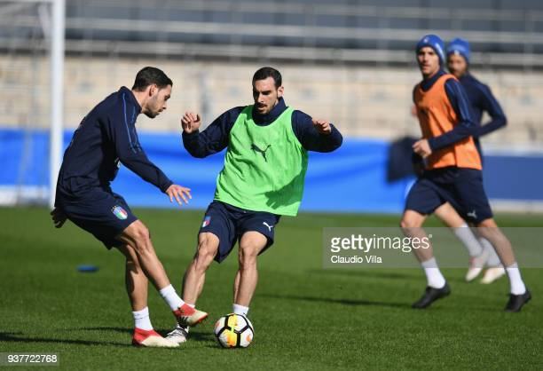 Mattia De Sciglio and Davide Zappacosta of Italy compete for the ball during a training session at Manchester City Football Academy on March 25 2018...