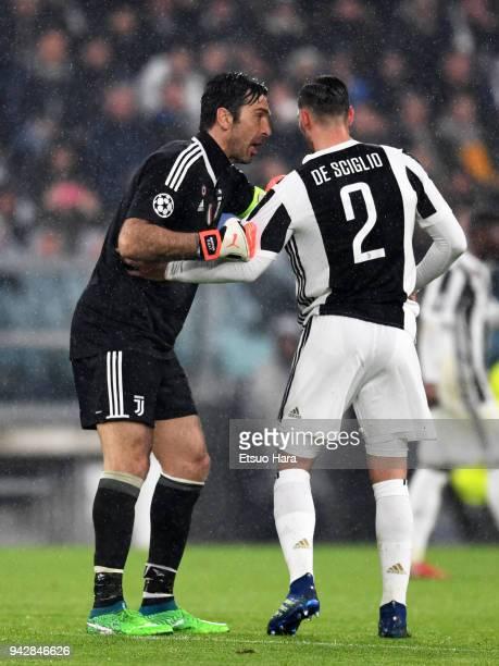 Mattia De Sciglio and Gianluigi Buffon of Juventus talk during the UEFA Champions League Quarter Final first leg between Juventus and Real Madrid at...