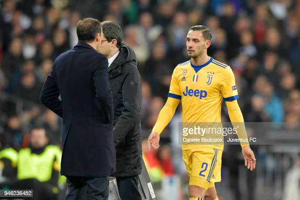 Mattia De Sciglio and Massimiliano Allegri of Juventus after the substitution during the Champions League match between Real Madrid and Juventus at...