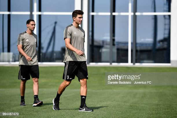 Mattia De Sciglio and Mattia Caldara during a Juventus training session at Juventus Training Center on July 9 2018 in Turin Italy