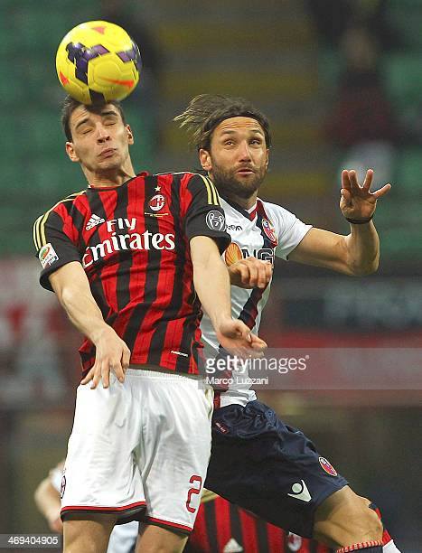 Mattia De Sciglio of AC Milan competes for the ball with Rolando Bianchi of Bologna FC during the Serie A match between AC Milan and Bologna FC at...