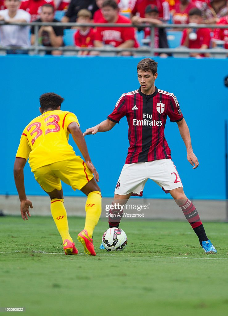 Mattia De Sciglio #2 of A.C. Milan keeps the ball away from Jordon Ibe #33 of Liverpool during second half action in the Guinness International Champions Cup at Bank of America Stadium on August 2, 2014 in Charlotte, North Carolina. Liverpool defeated A.C. Milan 2-0.
