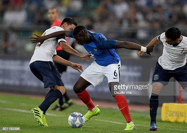 Mattia De Sciglio of Italy and Paul Pogba of France compete for the ball during the international friendly match between Italy and France at Stadio...